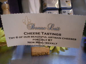 A sign advertising cheese tasting