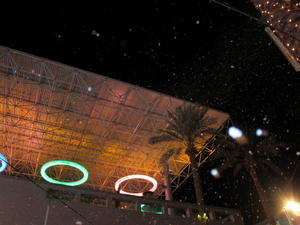 Snowflaling in front of lights at the snowfall in Tempe Marketplace.