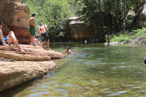 People swimming in Oak Creek