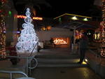 A lighted tree beside an outdoor fireplace in Tempe Marketplace